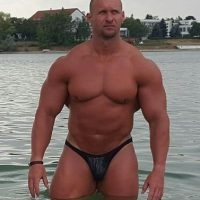 muscle dad posing in thong public