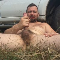 bloke wanking in woods