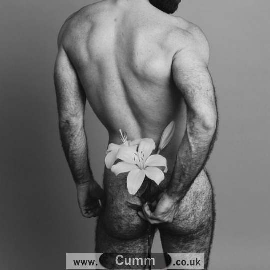 male model nude with flowers