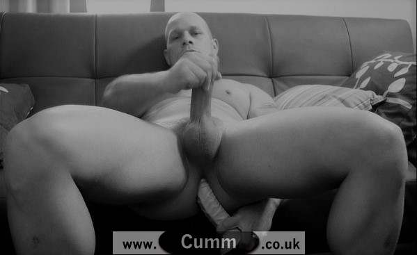 bald bloke wanking with dildo